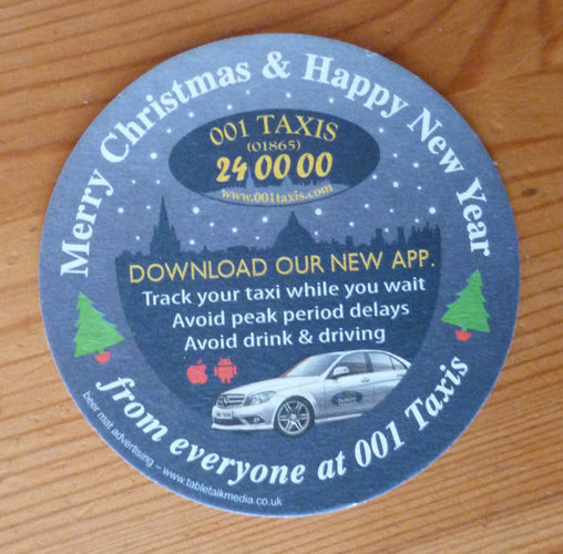 Beermat with taxi advert