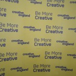 "A display banner with the words ""Be more creative"" in a repeat pattern."