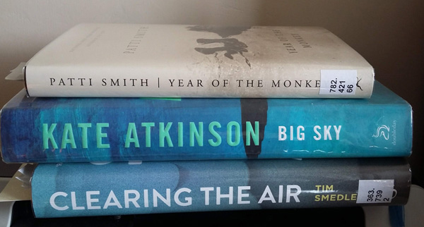 A pile of library books: Clearing the Air by Tim Smedley, Big Sky by Kate Atkinson and Year of the Monkey by Patti Smith.